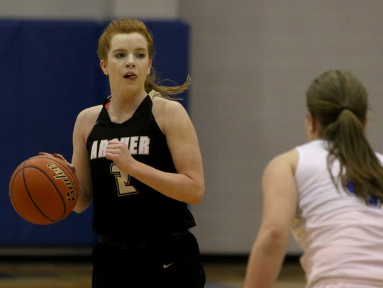 Archer City's Sierra Mooney dribbles in the game against