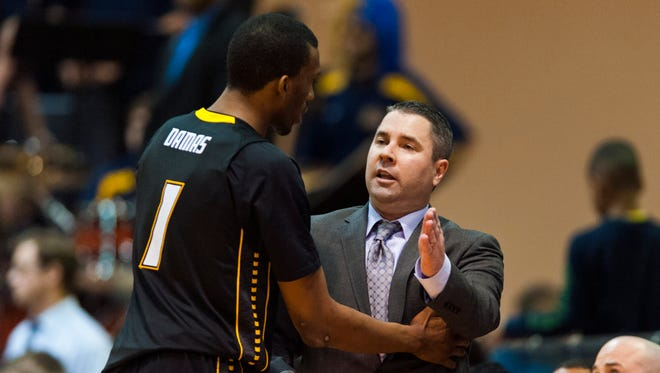 """Towson men's basketball coach Pat Skerry, shown here tutoring Tigers forward Marcus Damas, says losses gnaw at you while wins essentially are a """"relief."""""""