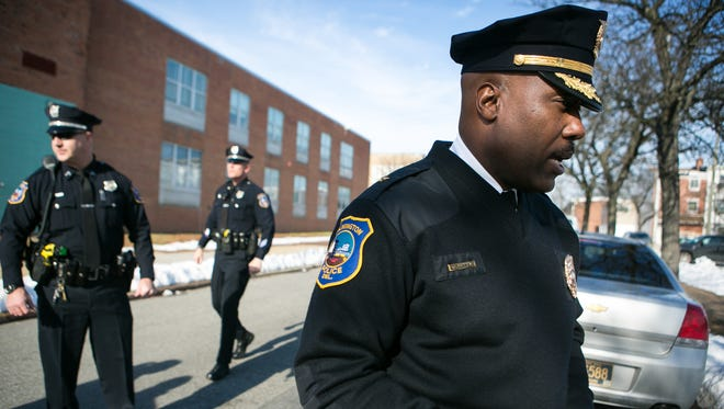 Police Chief Bobby Cummings walks with officers on Wilmington's East Side, which is the target area of an effort to combat quality-of-life crimes. Police are considering expanding the program to other areas of the community.