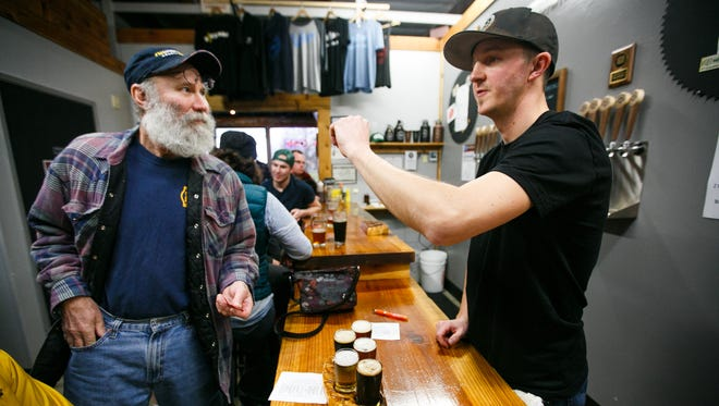 Chris Perry orders from Salem Ale Works co-founder Jake Bonham in February. On Saturday, Aug. 20, Salem Ale Works will celebrate its third anniversary.