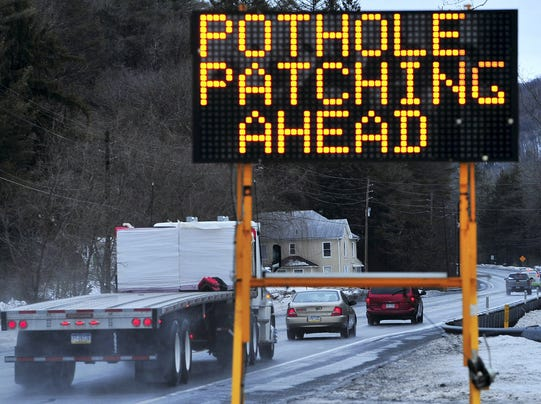AP Winter Weather Potholes