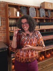 Owner of New Day Craft, Tia Agnew, holds a 32-ounce