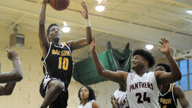Oak Grove senior Travez Ward takes the ball to the basket against Brookhaven in the West Jones Christmas Tournament on Friday in Laurel.