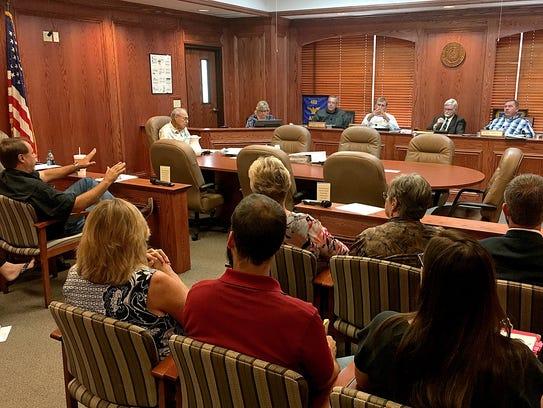 Wichita County Tax Assessor Tommy Smyth (left)  talks