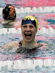 South Lyon Unified's Carolyn Bischoff is all smiles after breaking her own conference record in the 50 freestyle.