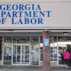 A woman walks into a Georgia Department of Labor career center in Atlanta in September, 2014.