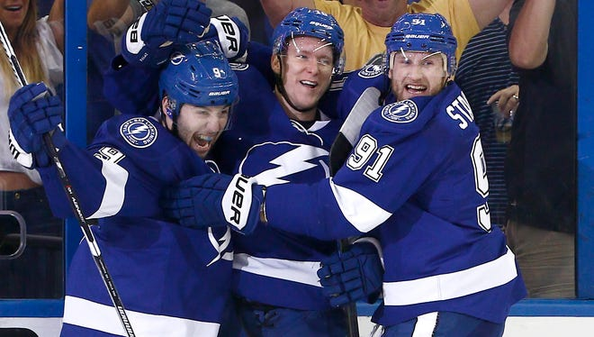 Tampa Bay Lightning left wing Ondrej Palat (center) center Tyler Johnson (9) and  Steven Stamkos (91) celebrates a goal during the second period against the Montreal Canadiens in game six of the second round of the 2015 Stanley Cup Playoffs at Amalie Arena.