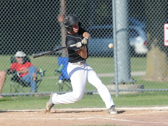 Lomira/Theresa's Mitch Brath swings at a pitch during Friday's game against Berlin in Brownsville.