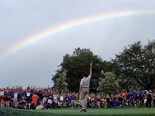 FILE - In this Aug. 17, 1997, file photo, a rainbow soars above Davis Love III, of Sea Island, Ga., after he won the PGA Championship at Winged Foot Golf Club in Mamaroneck, N.Y. Love is one of four players to be inducted into the World Golf Hall of Fame.  (AP Photo/Elise Amendola, File)