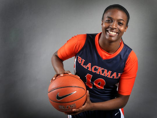 Meme Jackson is one of the players on the all-area girls basketball team. Photo shot in the studio on April 9, 2015.