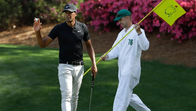 Tony Finau after putting on the 13th hole during the first round at the Masters golf tournament Thursday, April 5, 2018, in Augusta, Ga. (AP Photo/Matt Slocum)