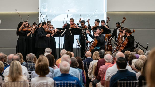 Members of the Chicago Symphony Quartet -- concertmaster Robert Chen, associate concertmaster Stephanie Jeong, violist Wei-Ting Kuo and assistant principal cello Kenneth Olsen -- play with students Monday from the Alexander W. Dreyfoos School of the Arts.