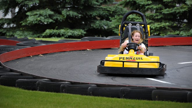 In this file photo, Bethany Bourgoin lets out a scream as she takes a tight corner in a go-kart at Summerland Family Fun Park in St. Cloud.  Jason Wachter, jwachter@stcloudtimes.com Bethany Bourgoin, 22, Inver Grove Heights, lets out a scream as she takes a tight corner in a go kart at Summerland Family Fun Park in Sauk Rapids  Wednesday, June 11.