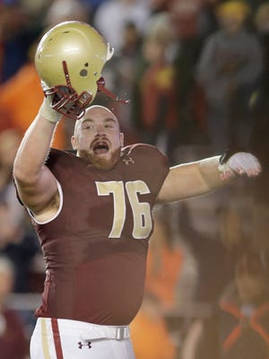 Boston College offensive linesman Bobby Vardaro (76) celebrates on the field as the clock runs out during the fourth quarter of their NCAA college football game against Southern California Saturday, Sept. 13, 2014 in Boston. Boston College defeated USC 37-31.