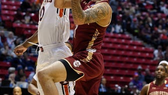 Charleston guard Grant Riller (1), right, shoots as Auburn guard Davion Mitchell (10) defends during the first half of a first-round NCAA college basketball tournament game Friday, March 16, 2018, in San Diego. (AP Photo/Denis Poroy)