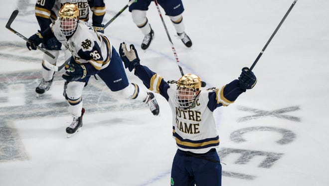Notre Dame's Jake Evans (18) celebrates his goal that won the semifinal for the Fighting Irish.