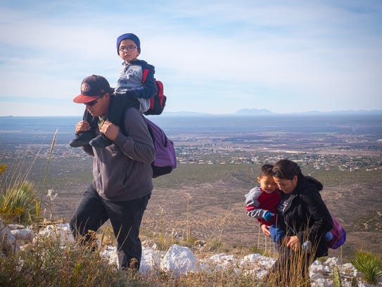 """Pilgrims make their way up Tortugas """"A"""" Mountain on"""