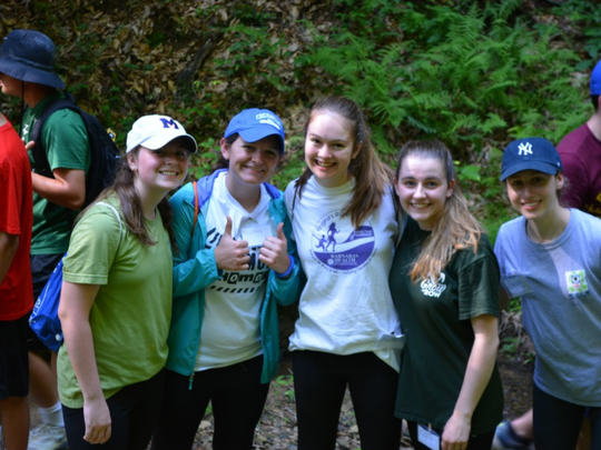 Mount Saint Mary Academy seniors Suzanne Hall, Elizabeth Cappucci, Kristen Moran, Virginia Ashby, and Lauren Zastko are pictured in Dunlow, West Virginia during their service trip with JusticeworX.
