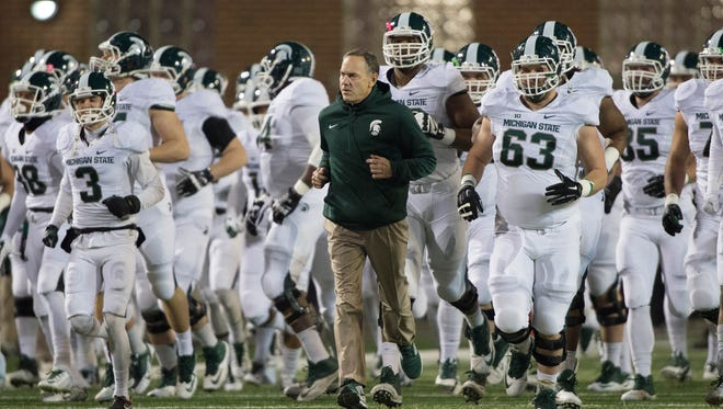 Michigan State Spartans head coach Mark Dantonio leads his team onto the field prior to the game against the Maryland Terrapins at Byrd Stadium.