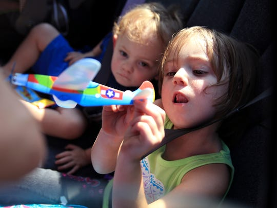 Nathaniel Dickey (left), 2, and Addyson Dickey, 4, play with donated airplanes at the Fulton Community Church on Thursday.