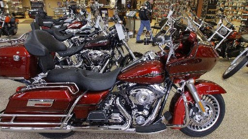 The Devils Diciples gang required its members to own Harley-Davidsons, shown in a showroom in Springfield, Ill., on April 25, 2012, and follow orders, such as intimidating others and lying to the police.