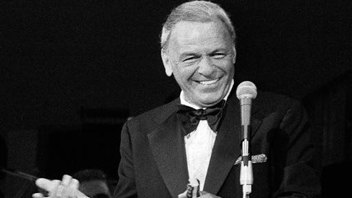 In  file photo, performer Frank Sinatra appears on the stage of the Westchester Premier Theater in Tarrytown, N.Y., during the opening night of his act with Dean Martin. Sinatra's first New Jersey driver's license has sold for $15,757 at auction. The yellowed, text-only 1934 license was issued, typo and all, to Francis Sintra, 841 Garden Street, Hoboken, New Jersey. The license was signed by the then-19-year-old a year before Sinatra got his first big break in the music industry.
