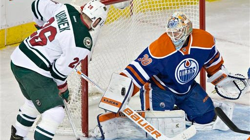 Minnesota Wild's Thomas Vanek (26) is stopped by Edmonton Oilers goalie Ben Scrivens (30) during the second period of an NHL hockey game Friday, Feb. 20, 2015, in Edmonton, Alberta. (AP Photo/The Canadian Press, Jason Franson)