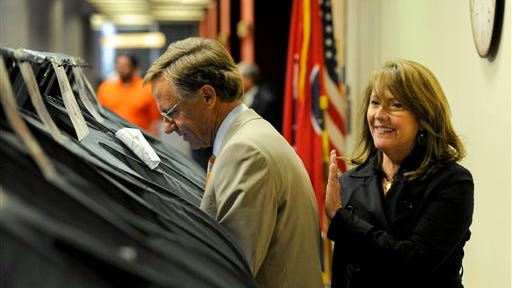 Gov. Bill Haslam, with his wife, Crissy, casts his ballot on the first day of early voting Friday, July 18, 2014, in Knoxville, Tenn. The State Primary and County General Election is Aug. 7. (AP Photo/Michael Patrick, Knoxville News Sentinel)