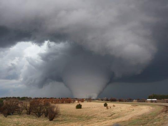 A deadly EF4 tornado roars near Fairdale, Ill., in