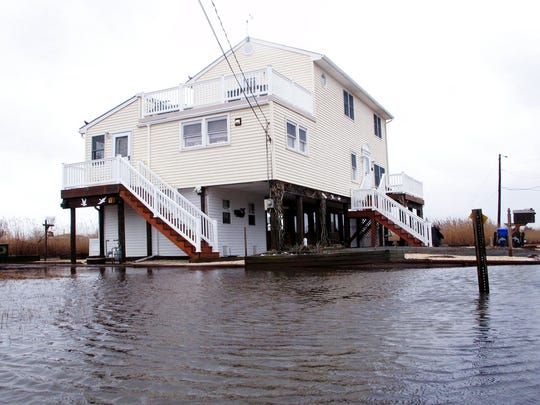 Jim and Maryann O'Neill's home in a back bay neighborhood of Manahawkin surrounded by water after a moderate storm in March 2017.