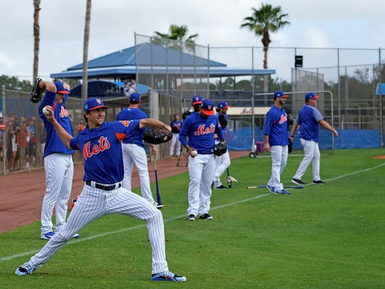 Jacob deGrom throws earlier in camp.