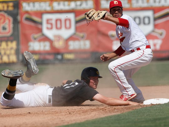Palm Desert High School's Jordan Sprinkle is unable to make the tag on a stolen base against Capistrano Valley in the first round CIF game at Palm Desert. Capistrano won 4-0.