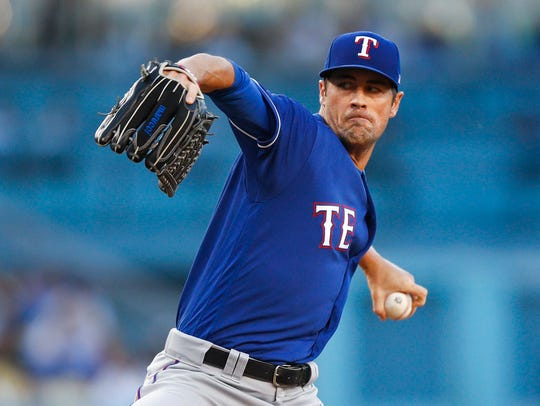 Texas Rangers starting pitcher Cole Hamels throws to