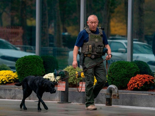 Photo shows a U.S. Marshal walking with a security