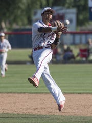 Tulare Western's Blaze Hickey throws to first against Tulare Union in a East Yosemite high school baseball game on Thursday, May 11, 2017.