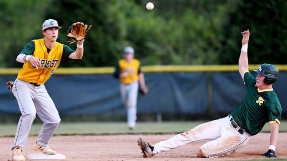 Reynolds' Talon James is out at second as Crest's Riley