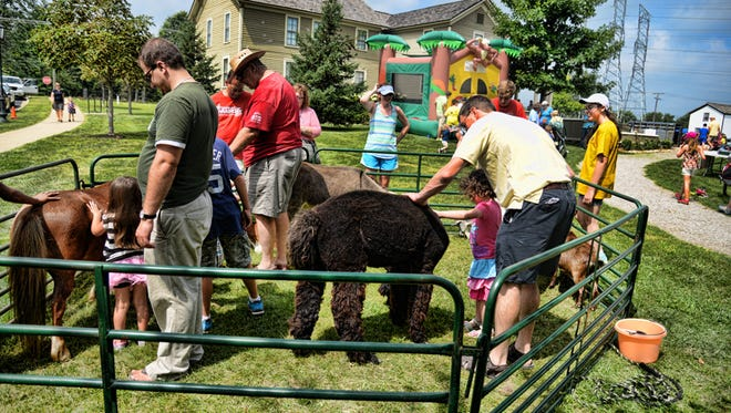 A petting farm is one of the many events scheduled for the corn roast.