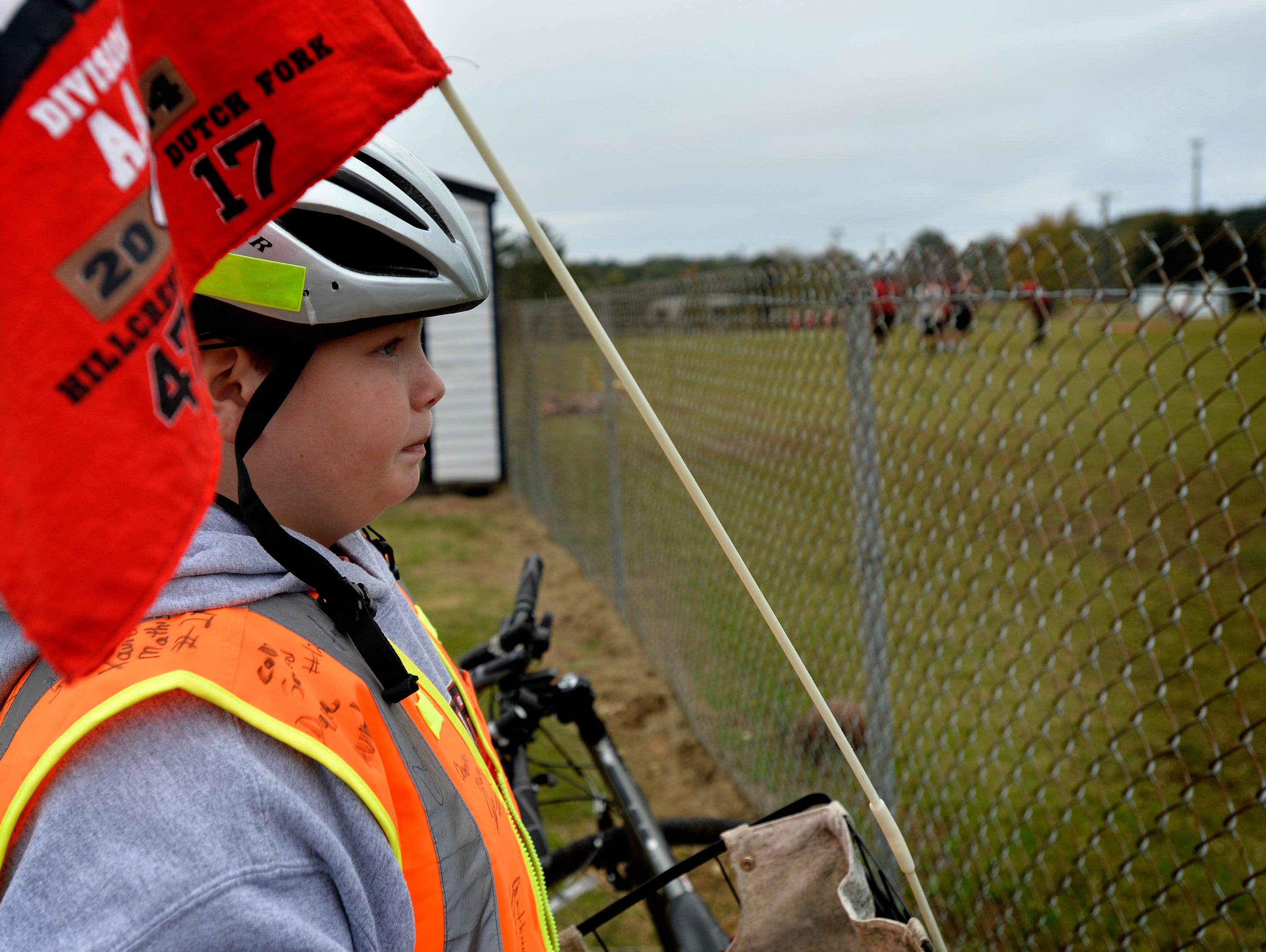 11-year-old Andrew Pepper watches the Hillcrest High School Rams practice on Nov. 5, 2015. Pepper rides his bike to every Rams football game.