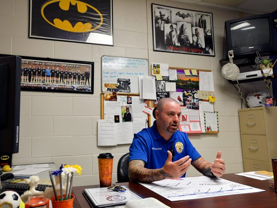 """Tony Koutsos, a school resource officer at Mauldin High School, says he likes to keep his office comfortable for the students. """"I want them to come in here and talk but not feel like they're in jail,"""" said Koutsos on Nov. 6, 2015."""
