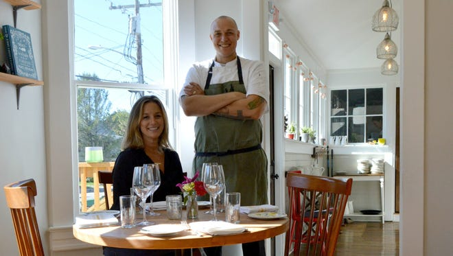 Meghan Lee and Matt Kern smile inside Heirloom, located in downtown Lewes.