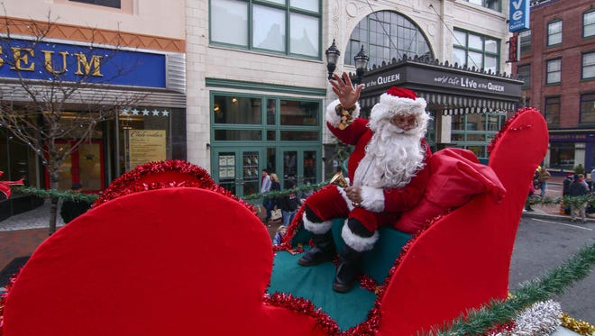 Santa waves to crowd during the Wilmington Jaycees 53rd annual Christmas parade in Wilmington.