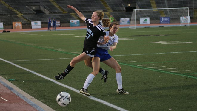 Players from Loyola and Vanderbilt Catholic collide in Wednesday's Division III state championship girls soccer game vs. Vandebilt Catholic at Tad Gormley Stadium in New Orleans.