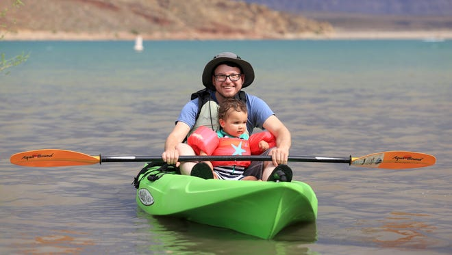 Brian Passey kayaks with his nephew, Vale, at Quail Creek Reservoir in Hurricane.