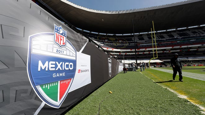 Preparations continue at Aztec Stadium in Mexico City for the game between the Oakland Raiders and New England Patriots.