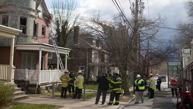 Wilmington firefighters work the scene of a house fire on the 2100 block of Washington Street Thursday afternoon.