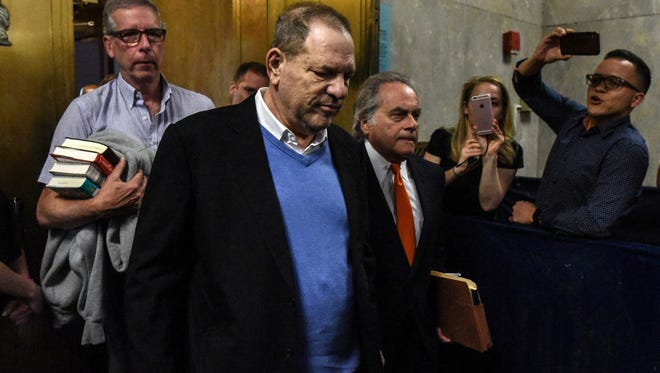 Harvey Weinstein exits the court room with his lawyer Benjamin Brafman after his arraignment at Manhattan Criminal Court on May 25, 2018 in New York City.