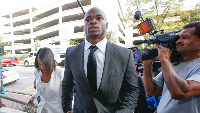Minnesota Vikings running back Adrian Peterson enters the Montgomery county courthouse for his arraignment.