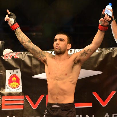 Leandro Issa celebrates after defeating Ulka Sasaki during UFC Fight Night at Jose Correa Arena.