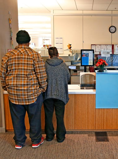 After filling out the needed paperwork,  applicants for Section 8 help from the Chandler's Housing Office deliver their applications on Jan. 11, 2016