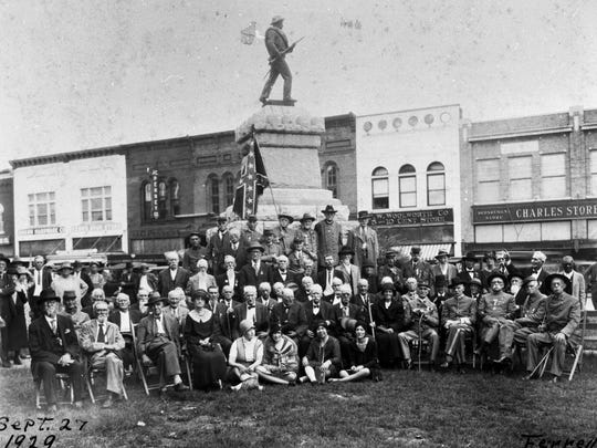 Confederate Civil War Veterans posing in front of the
